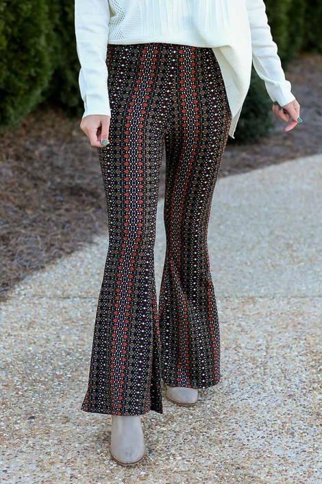 Close up of the Print Knit Bell Bottom Pants in Rust