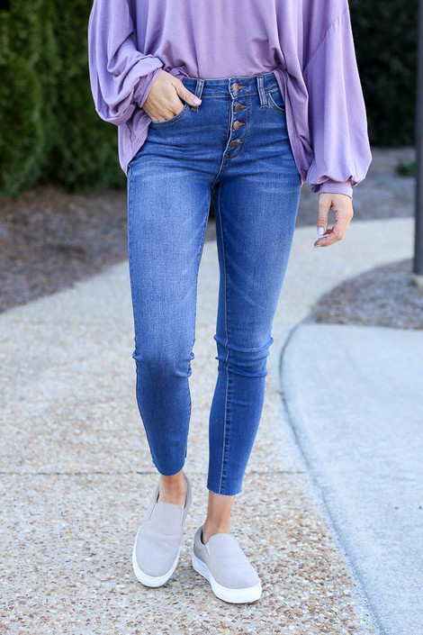 Close up of the High-Rise Button Front Skinny Jeans in Medium Wash