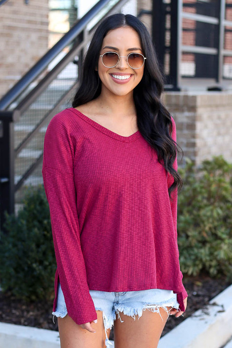 Model wearing the Ribbed Knit Top in Burgundy with denim shorts