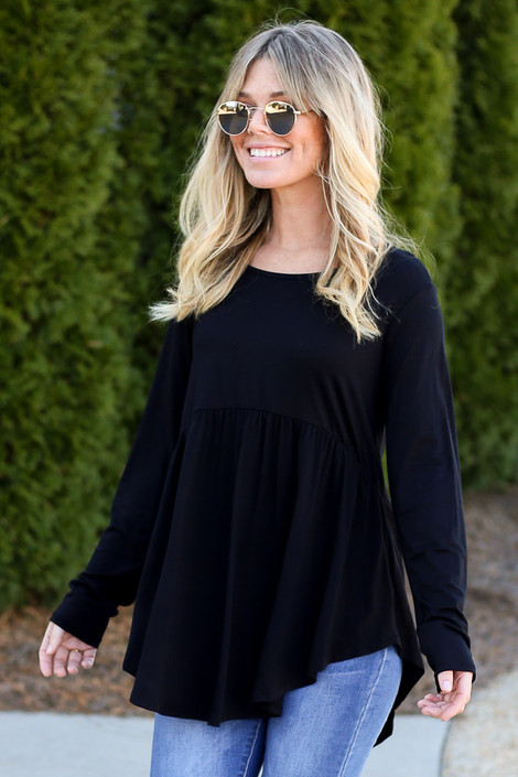 Model wearing the Soft Knit Babydoll Top in Black
