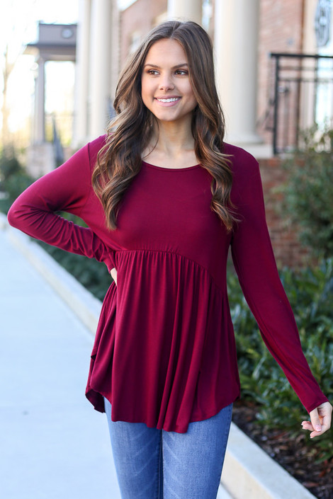 Model wearing the Soft Knit Babydoll Top in Burgundy
