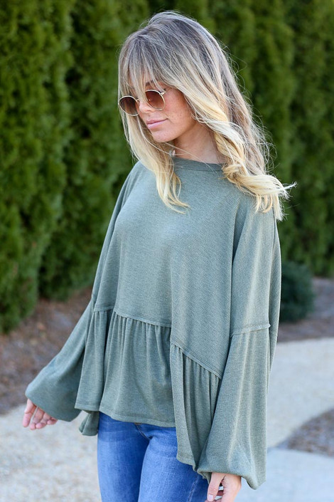 Model wearing the Balloon Sleeve Oversized Babydoll Top in Olive