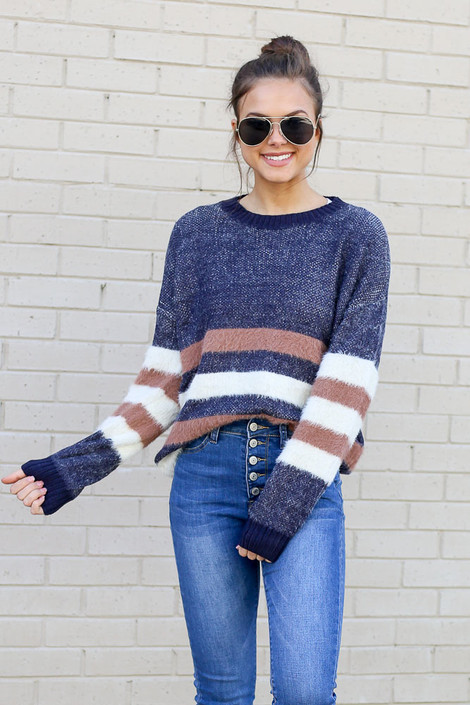 Model wearing the Striped Eyelash Knit Sweater tucked into skinny jeans