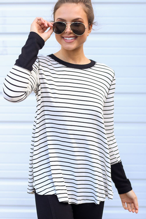 White - Close up of a Dress Up model wearing the Striped Ribbed Knit Top in White