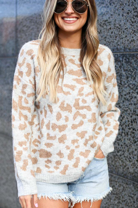 Model wearing the Leopard Brushed Knit Sweater with denim cut off shorts Close Up Front View