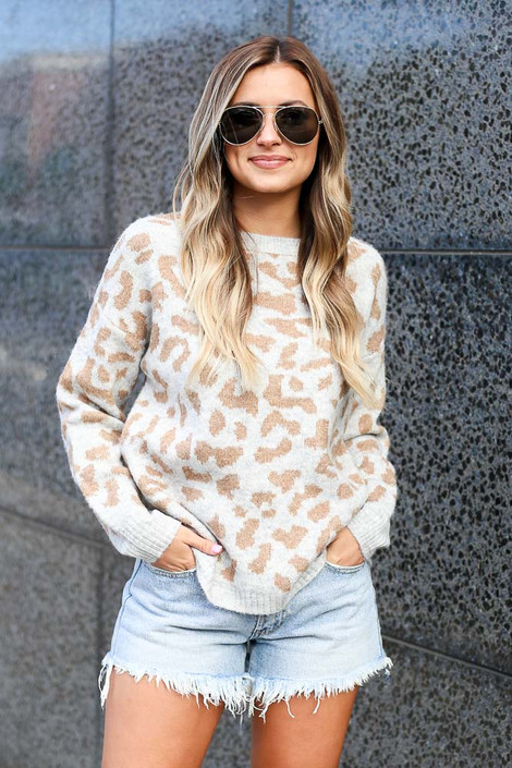 Model wearing the Leopard Brushed Knit Sweater with denim cut off shorts Front View