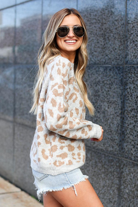 Model wearing the Leopard Brushed Knit Sweater with denim cut off shorts Side View