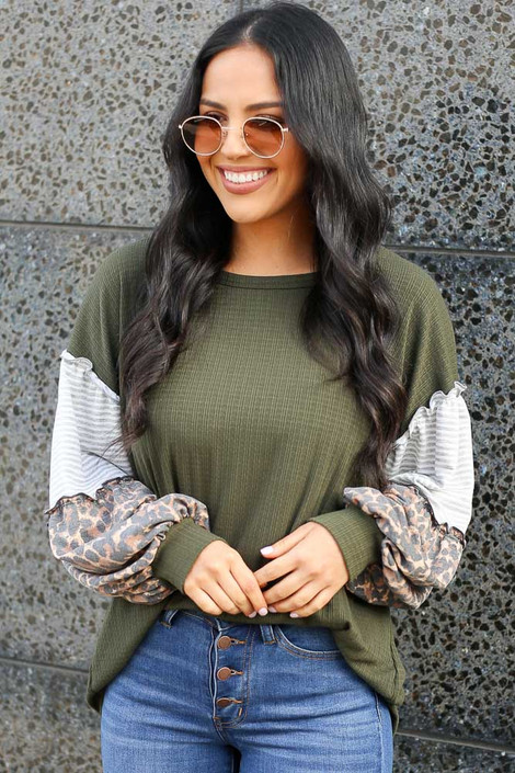 Dress Up model wearing the Statement Sleeve Ribbed Knit Top in Olive tucked into medium wash jeans