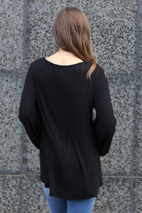 Model wearing the Black Tie Front Balloon Sleeve Ribbed Knit Tunic from Dress Up Back View