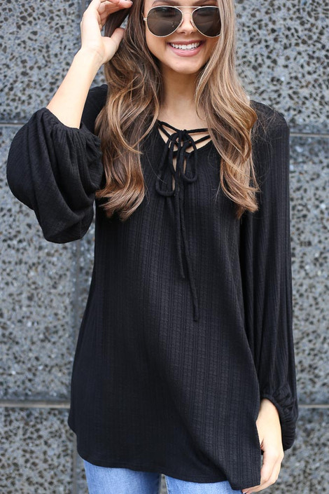 Model wearing the Black Tie Front Balloon Sleeve Ribbed Knit Tunic from Dress Up Close Up Front View