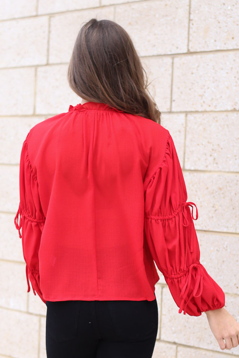 Model wearing the Puff Sleeve Blouse in Red Back View