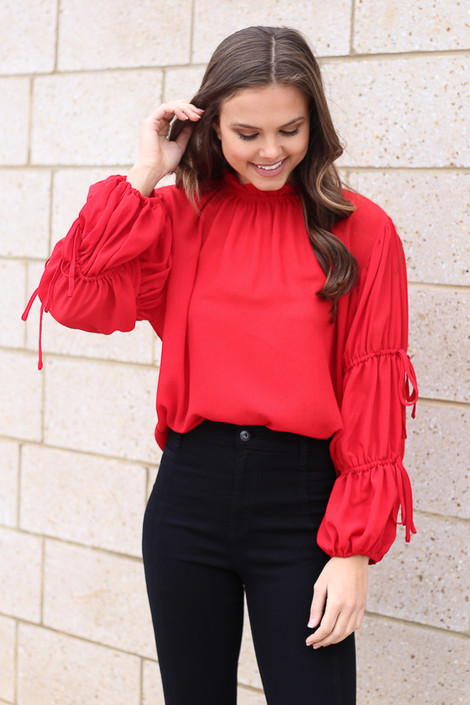 Dress Up model wearing the Puff Sleeve Blouse in Red