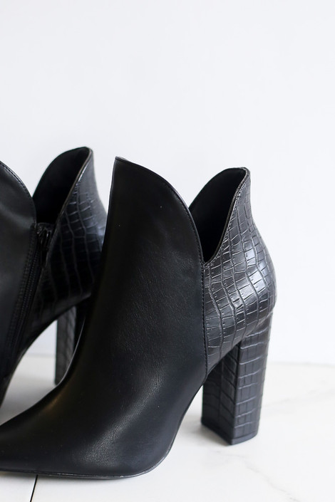 Close up of the Crocodile V-Cut Booties in Black