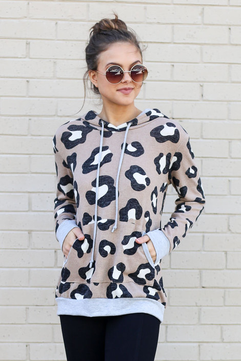 Model wearing the Leopard Brushed Knit Hoodie