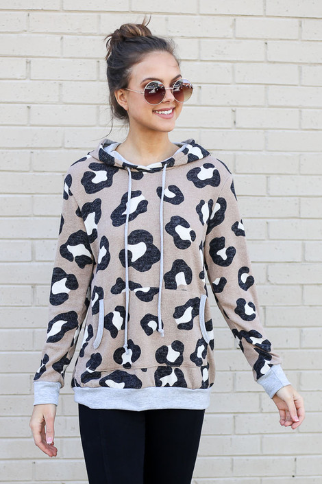 Model wearing the Leopard Brushed Knit Hoodie in Taupe