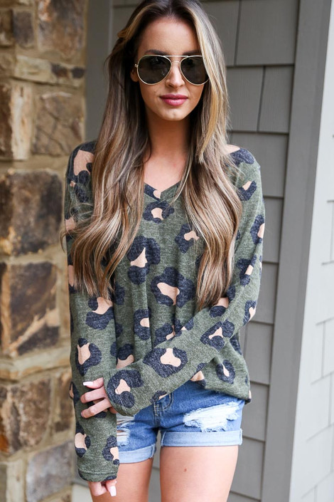 Model wearing Olive Brushed Knit Leopard Top with denim shorts from online dress boutique