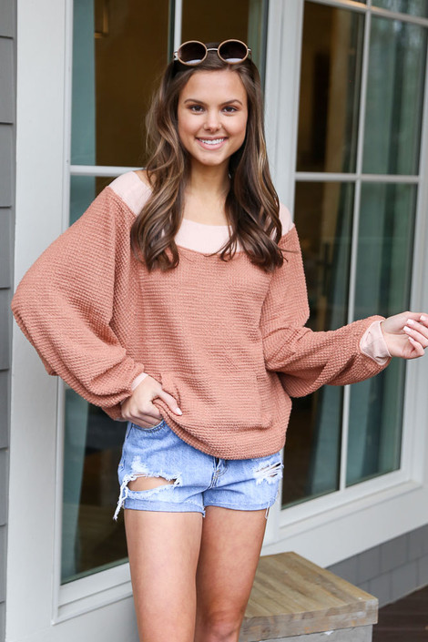 Model wearing the Rust Oversized Waffle Knit Contrast Pullover from Dress Up