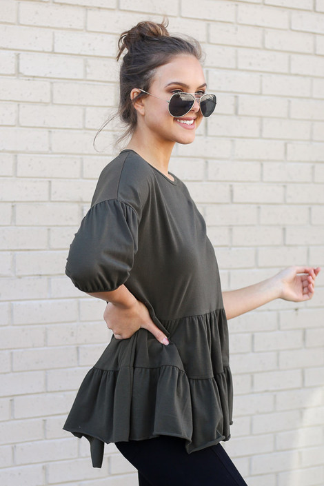 Model wearing the Tiered Babydoll Top in Olive Side View