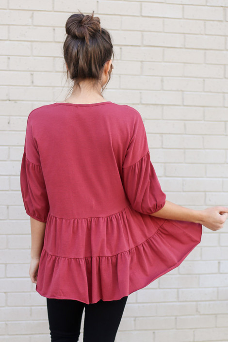 Model wearing the Tiered Babydoll Top in Marsala Back View
