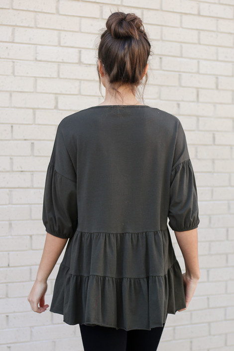 Model wearing the Tiered Babydoll Top in Olive Back View