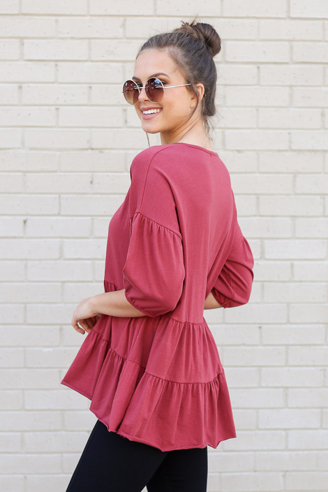 Model wearing the Tiered Babydoll Top in Marsala Side View