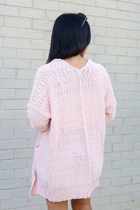 Model wearing the Popcorn Knit Sweater Cardigan in Blush from Dress Up Back View