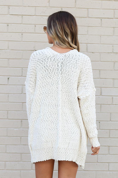 Model wearing the Popcorn Knit Sweater Cardigan in Ivory from Dress Up Back View