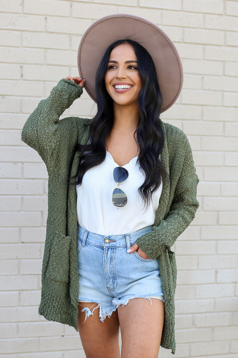 Model wearing the Popcorn Knit Sweater Cardigan in Olive from Dress Up Front View