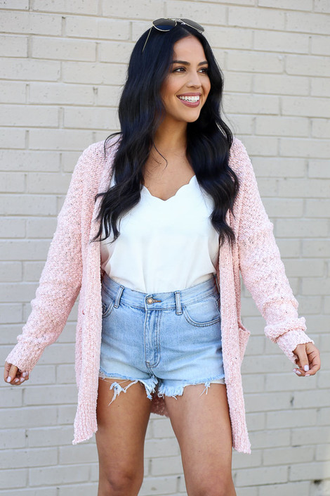Model wearing the Popcorn Knit Sweater Cardigan in Blush with tank bodysuit and denim shorts from Dress Up Front View