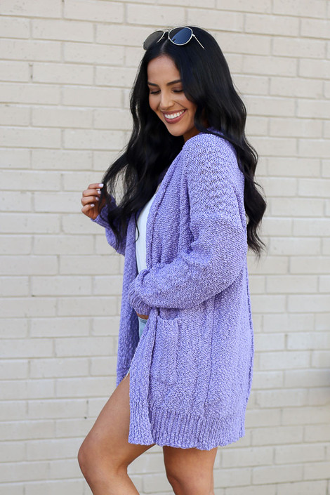 Model wearing the Popcorn Knit Sweater Cardigan in Lilac from Dress Up Side View