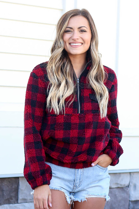 Dress Up model wearing the Buffalo Plaid Sherpa Quarter Zip Pullover in Red