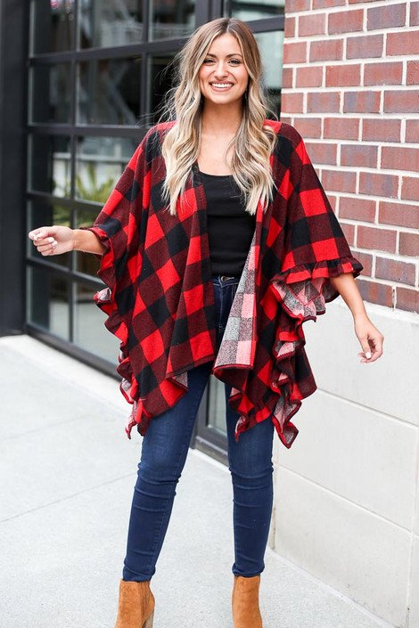 Dress Up model wearing the Buffalo Plaid Ruffle Sleeve Cardigan in Red with a black tank and dark wash jeans