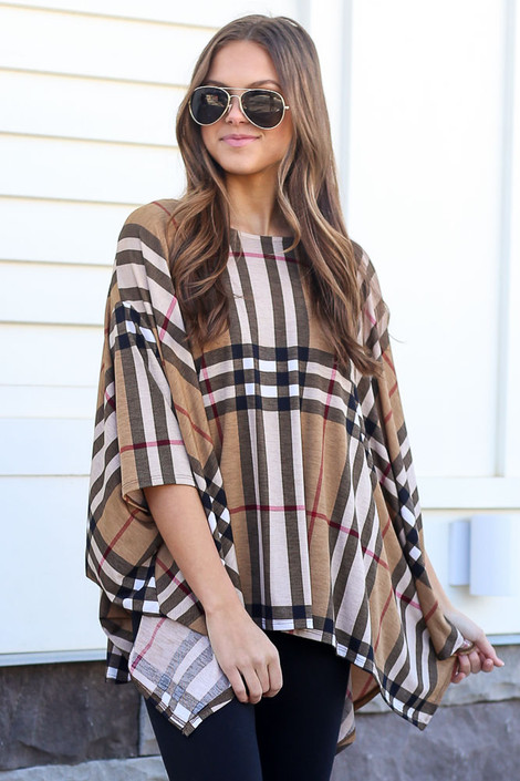 Model wearing the Taupe Plaid Oversized Top with black skinny jeans from online dress boutique Front View