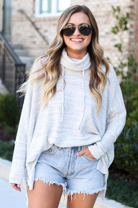 Model wearing the Brushed Knit Cowl Neck Oversized Pullover with denim shorts