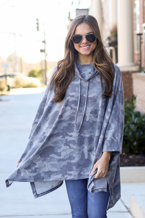 Grey - Model wearing the Grey Brushed Knit Cowl Neck Camo Poncho with high rise jeans from Dress Up Front View