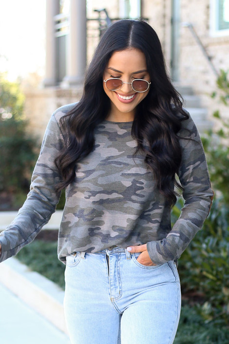 Model wearing the Elbow Patch Camo Top with high rise light wash jeans from Dress Up Front View