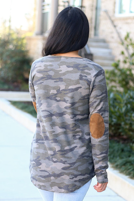 Model wearing the Elbow Patch Camo Top with high rise light wash jeans from Dress Up Boutique  Back View
