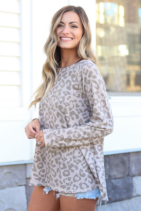Model wearing the Taupe Leopard Oversized Tie-Back Top with cut off shorts and sneakers from online dress boutique Side View