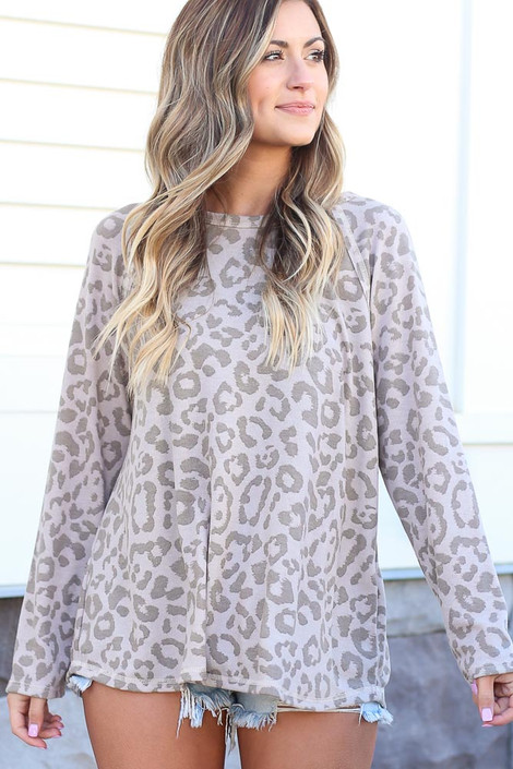 Model wearing the Taupe Leopard Oversized Tie-Back Top with cut off shorts and sneakers from online dress boutique Front View
