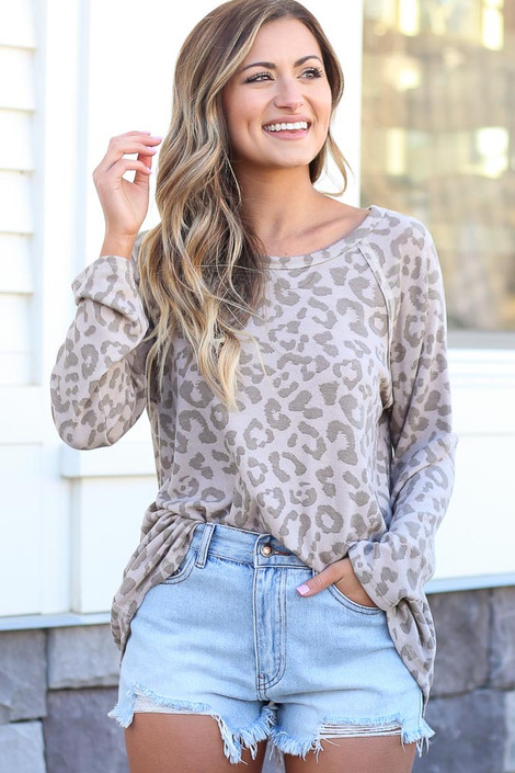 Model wearing the Leopard Brushed Knit Top with distressed denim shorts from Dress Up Front  View