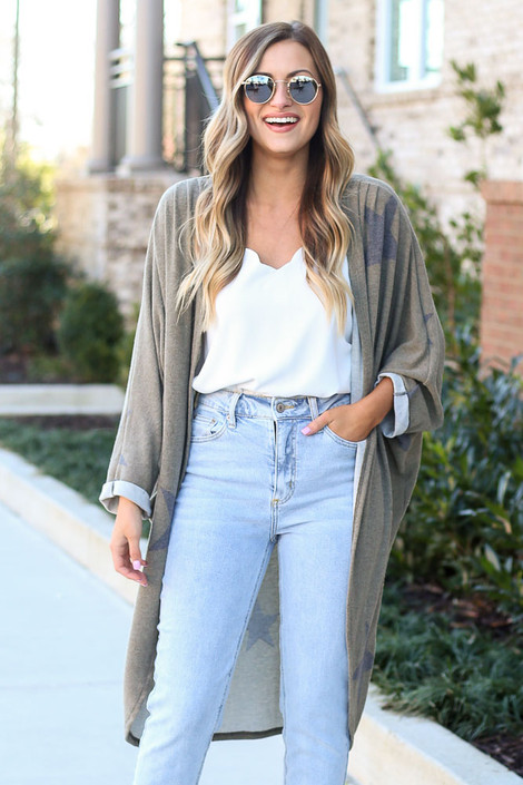 Model wearing the Star Brushed Knit Longline Cardigan with high rise jeans and white tank top from Dress Up Side View