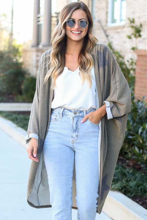 Model wearing the Star Brushed Knit Longline Cardigan with high rise jeans from DressUp Front View