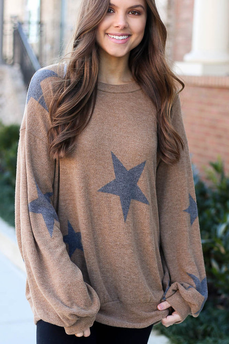 Model wearing the Taupe Star Brushed Knit Oversized star sweatshirt  with high rise leggings from DressUp Front View