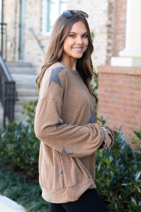 Model wearing the Taupe Star Brushed Knit Oversized Pullover with high rise leggings from DressUp Side View