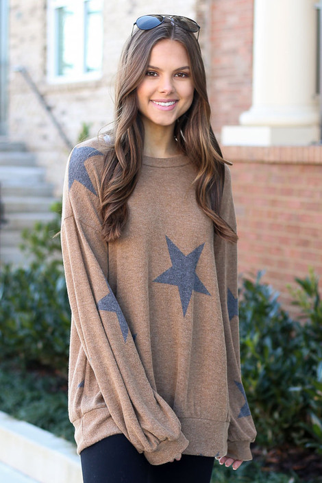 Model wearing the Star star sweatshirt  with athleisure leggings and trendy sneakers from Dress Up