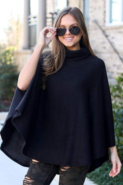Model wearing the Brushed Knit Cowl Neck Oversized Poncho in Black with leggings from Dress Up Front View