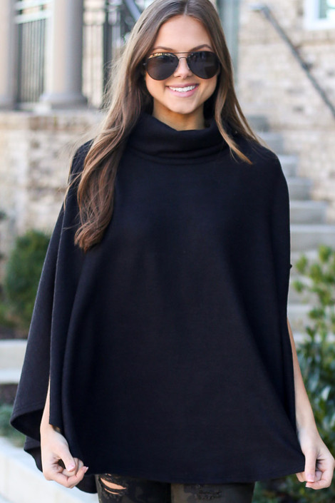 Model wearing the Brushed Knit Cowl Neck Oversized Poncho in Black with leggings from Dress Up Boutique