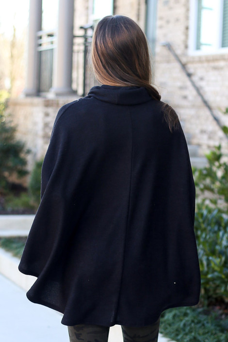 Model wearing the Brushed Knit Cowl Neck Oversized Poncho in Black with leggings from Dress Up Back View