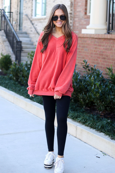 Model wearing the Oversized Fuzzy Knit Pullover in Coral