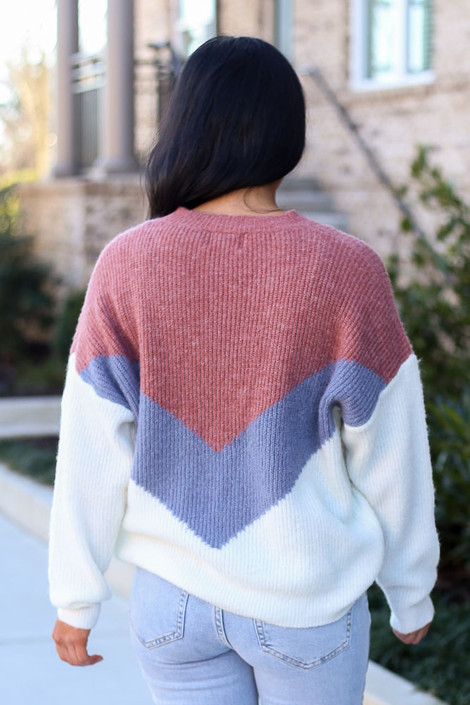Model wearing the Color Block Sweater in Mauve with high rise jeans from Dress Up Back View